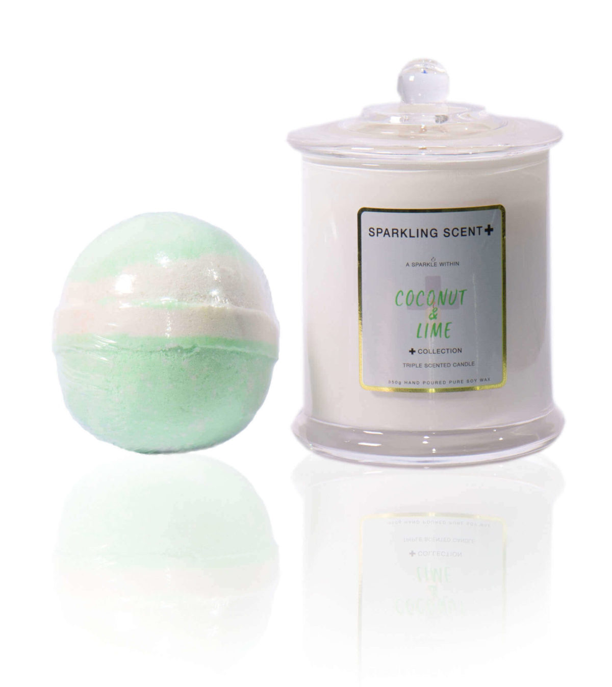 Green and cream Coconut & Lime gift set in the centre of the screen. A bright mica green Bomb bomb and a Glossy White Elegant French Gala candle.