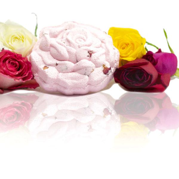 Rose petal bath bomb shaped as a detailed rose with a wavy pattern on top in the centre of the screen surrounded by all different coloured roses.