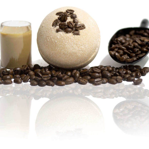 Coffee beans in a Bath Bomb? Yep! This brown bath bomb sitting in the centre of the screen surrounded with coffee beans, espresso shot and a big coffee bean scoop, showing you the scent in a picture. Wait until you smell it for yourself.