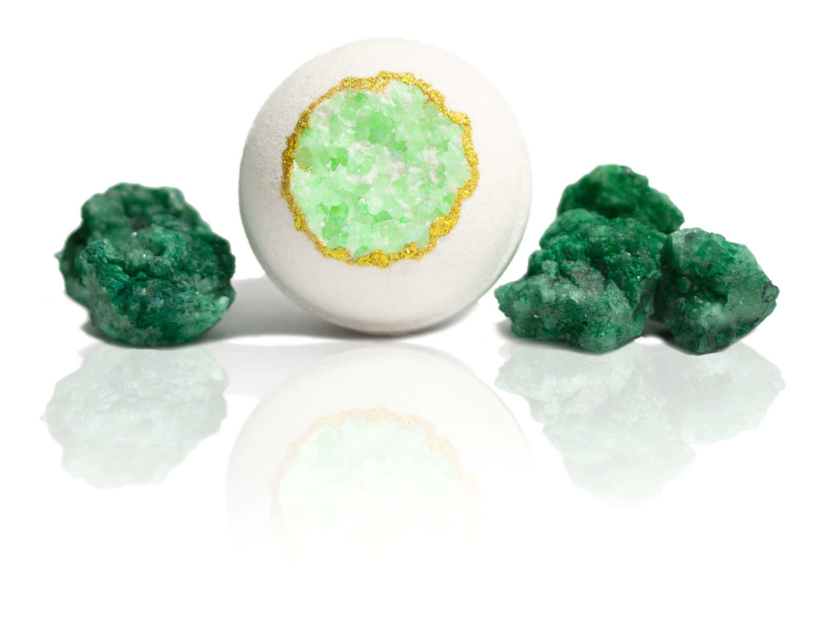 Green Quartz Druzy Bath Bomb sitting in the centre of the screen surrounded with green Druzy Quartz showing you the scent in in a picture. Wait until you smell it for yourself.