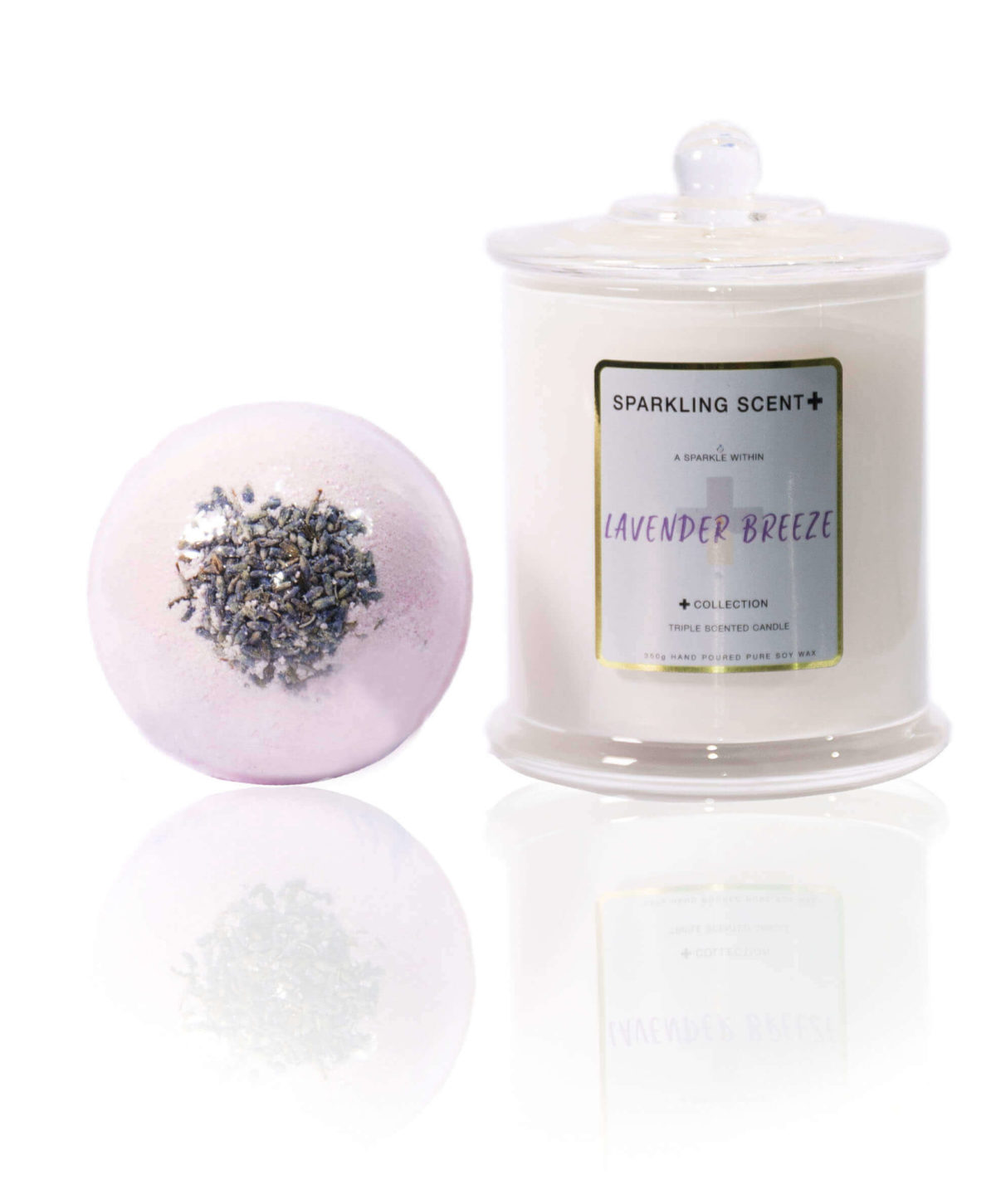Lavender gift set in the centre of the screen. A bright mica purple Botanical Lavender flower Bomb bomb and a Glossy White Elegant French Gala candle.