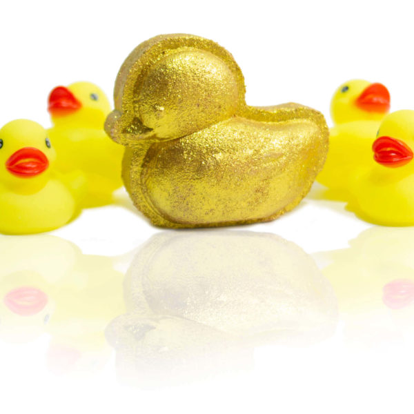 Gold Ducky bath bomb in the centre of the screen surrounded by yellow bath ducky.
