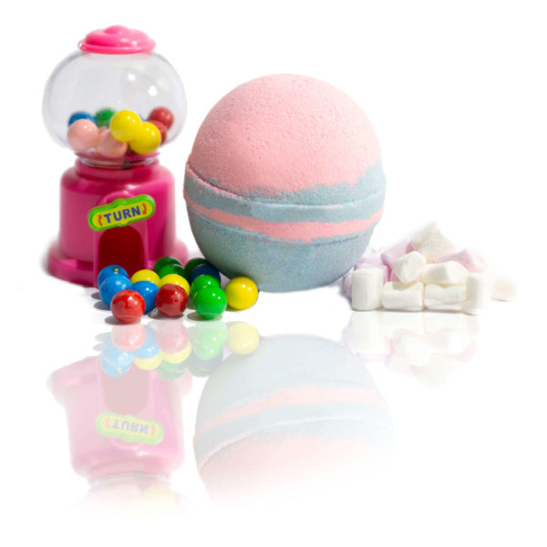 Pink & blue Bubble Gum Bath Bomb sitting in the centre of the screen surrounded with light bubble gum machines and marshmellows. showing you the scent in in a picture. Bet Wait until you smell it for yourself.