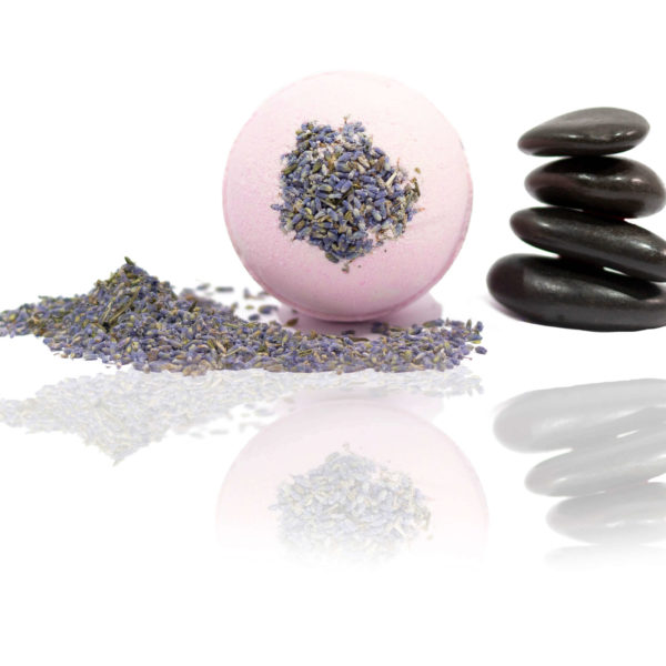 Lavender Bath Bomb with lavender and calming rocks surrounding the purple bath bomb with lavender in the bath bomb.