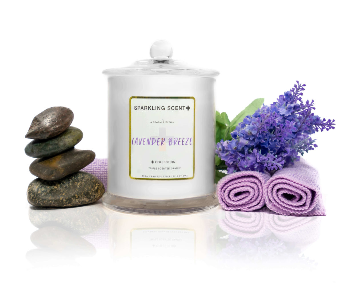 Glossy white shining French Gala Candle with a gold and white sticker. Surrounded by what you can imagine from the scent. Lavender bush, relaxing massage stones & lavender steam towels.