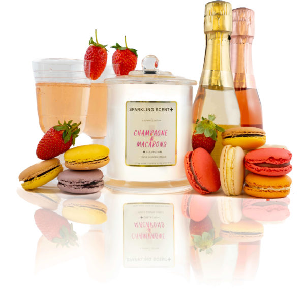 Glossy white shining French Gala Candle with a gold and white sticker. Surrounded by what you can imagine from the scent. Lots of vibrant Macarons, fresh strawberries and champagne.