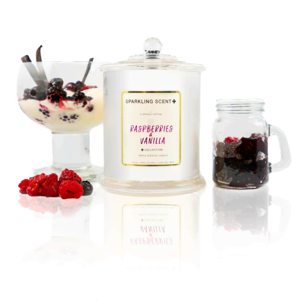 Glossy white shining French Gala Candle with a gold and white sticker. Surrounded by what you can imagine from the scent. Black & Red Raspberries along with vanilla sticks in a dessert jar.