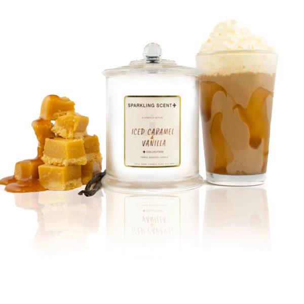 Glossy white shining French Gala Candle with a gold and white sticker. Surrounded by what you can imagine from the scent. Vanilla sticks, iced Caramel frape and caramel squares drizzled with caramel sauce.